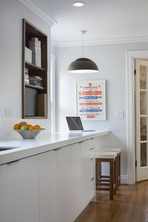Fein also renovated the kitchen in a 1930s bungalow in Kansas City, Missouri. The countertop of a custom cabinet creates a breakfast nook at one end.