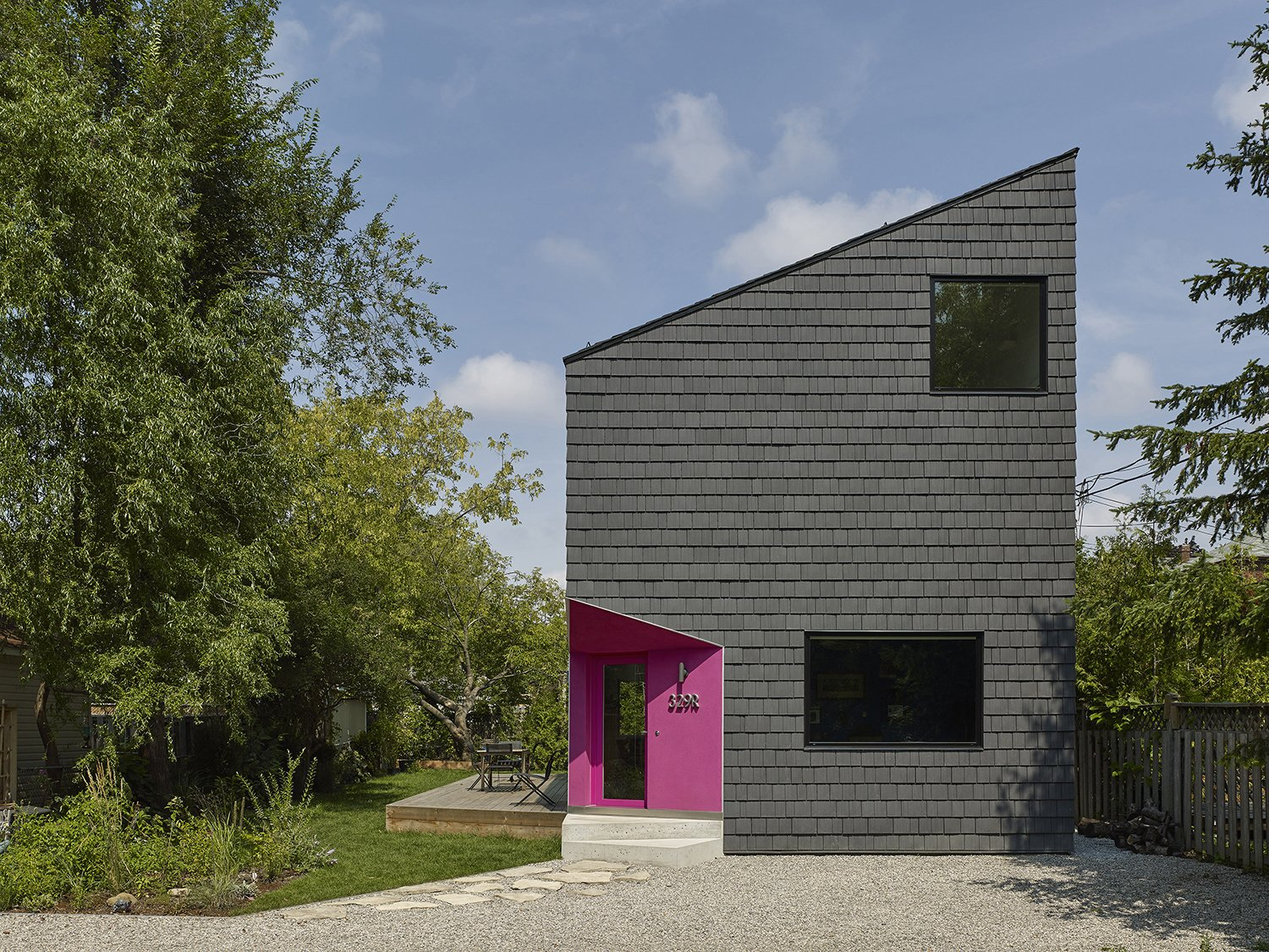 The house has a striking facade: The sharply angled roofline eschews conventional geometries. The structure is clad in a durable roof shake manufactured by Enviroshake that doesn't require any maintenance after installation.