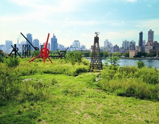 "The Evolution of an Urban Wasteland: Socrates Sculpture Park at 30 - Photo 2 of 8 - The park, newly transformed into a public art space in 1986. Mark di Suvero's red-painted steel sculpture, ""Old Glory,"" is one of the pieces pictured."