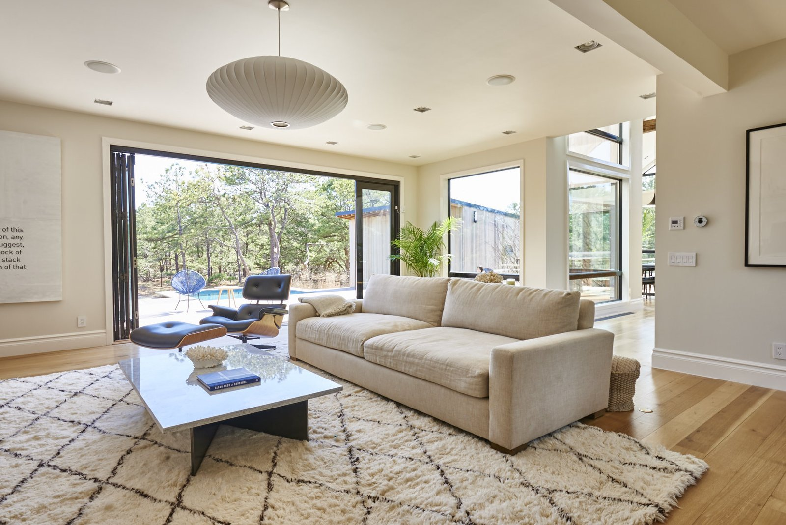 Solid white oak flooring is installed throughout. The home's windows and doors are by Andersen Windows.