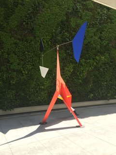 Standing proud in one of the outdoor spaces is Alexander Calder's Big Crinkly, an animated painted metal sculpture from 1969. Visitors can wander freely around this piece in an area that's framed by a wall of lush greenery.