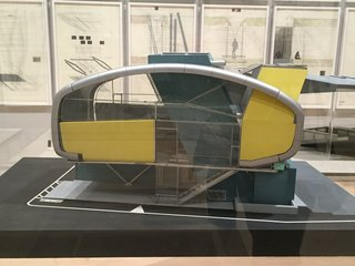 """In an adjacent room, various forms of experimental architecture are explored with renderings, sculptures, models, and sketches. Shown here is Neil M. Denari's model for Prototype House, Tokyo, created from 1992 to 1993. Though this design was never actually built, it represented his idea of creating """"living machines"""" as a solution to confined urban living."""