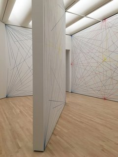 Another experiential room included Sol LeWitt's Wall Drawing 273. Originally imagined by LeWitt in 1975, the intersecting lines were drawn on the walls with graphite and crayon. With a set of instructions on how to apply the design, it was devised to be implemented into any location and to respond to different light and dimensions. Thus, these lines will be painted over when the exhibition ends.