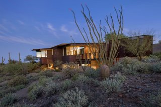 Taking it to the Desert With Dwell Home Tours - Photo 8 of 12 - We'll also be exploring the Byrne Residence, another home designed by Will Bruder of Will Bruder Architects. With the implementation of patios and courtyards with both shaded and exposed areas, this sculptural house is built for year-round indoor/outdoor living. The angular orientation of the structure allows for optimal views of the Sonoran Desert.