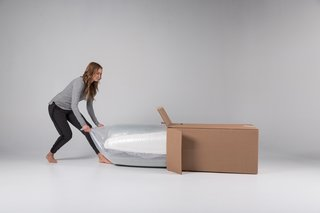 The Mattress Company That Lets You Be Your Own Expert - Photo 4 of 7 - When a Luxi mattress is delivered to your door, it's held within a convenient box and carefully rolled up in a protective wrap.