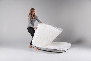 The Mattress Company That Lets You Be Your Own Expert - Photo 5 of 7 - The next step is to unroll the mattress—and it's ready to go. After opening the package and placing it where desired, the only thing left to do is unzip it and adjust the layers to your preference.