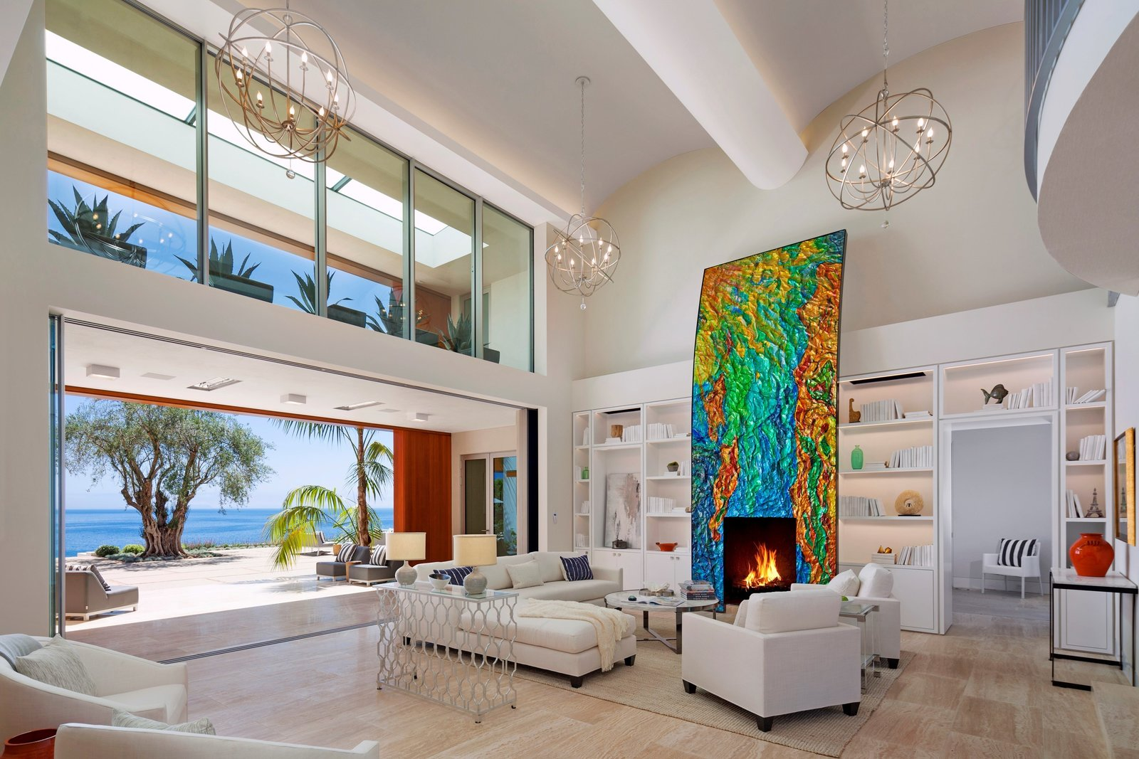 Located in the Hope Ranch neighborhood of Santa Barbara, California, this striking home sits on an almost four-acre bluff with over 200 feet of ocean contact. The art-adorned fireplace acts as the centerpiece of the living room that opens up to unobstructed views of the Pacific Ocean.  97+ Modern Fireplace Ideas by Dwell from Proof That a Modern Fireplace Can Be the Defining Factor of a Space