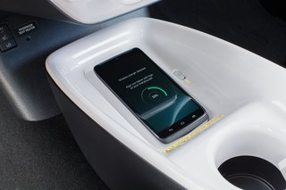 Hitting the Road With the Newest Hybrid Technologies - Photo 4 of 8 - With the Qi-compatible wireless smartphone charging system*, you can charge your phone by placing a compatible device onto the nonslip surface.  *The Qi wireless charging may not be compatible with all mobile phones, MP3/WMA players, and like models. When using the wireless charging system, avoid placing metal objects between the wireless charger and the mobile device when charging is active. Doing so may cause metal objects to become hot and could cause burns. To prevent damage to devices, do not leave the devices in the vehicle. Temperature inside may become high, resulting in damage to the device.