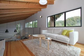 """A Passion for Design Guides the Creation of a Nordic-Inspired Home - Photo 5 of 9 - Loewinger points out, """"The mezzanine has become the fun room in the house. The kids and their friends regularly hang out up there, without being too separated from the rest of the family."""""""