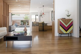 Meet Us in Los Angeles for Our Biggest Home Tour Yet - Photo 2 of 17 - DEX Studio designed this home for a family with Midwestern roots who wanted to be able to enjoy indoor/outdoor living as much as possible. The wood from the exterior continues indoors where it helps divide the public and private spaces. Large surface mounted sliding doors open up to the backyard and pool.