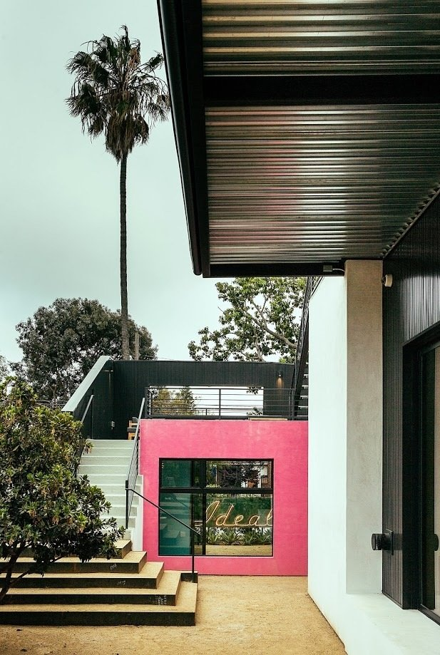 When collaborating with the homeowner on this project, Rudin referenced the case study houses of Southern California as well as the eclectic and experimental architecture of the '70s and '80s. He utilized vertical metal siding and bright colors to define spaces marked by art.