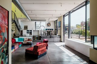 Meet Us in Los Angeles for Our Biggest Home Tour Yet - Photo 12 of 17 - The interior makes a bold statement with the extensive use of industrial glass and exposed steel and duct work.