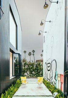 Meet Us in Los Angeles for Our Biggest Home Tour Yet - Photo 13 of 17 - While exploring its extensive outdoor art collection, you'll find a 25-foot, two-story mural that was the first residential commission by Parisian street artist, Invader.