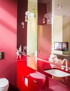 Meet Us in Los Angeles for Our Biggest Home Tour Yet - Photo 14 of 17 - The vibrant color scheme is continued throughout the property, even into the smallest of spaces—as shown here in one of the bathrooms.