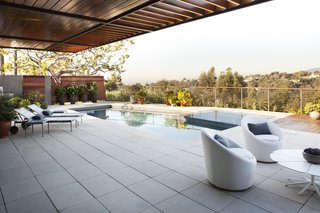 Meet Us in Los Angeles for Our Biggest Home Tour Yet - Photo 16 of 17 - Adelaide Place is run by a LEED Gold-level environmental program that includes the use of recycled materials and a solar power system. Each of the levels integrate open indoor/outdoor spaces, including the pool deck that's partly shaded by a dramatic overhang.