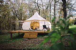 The Schulman yurt fits three adults with a queen bed and a pull-away bed. It comes with heating and bath essentials.