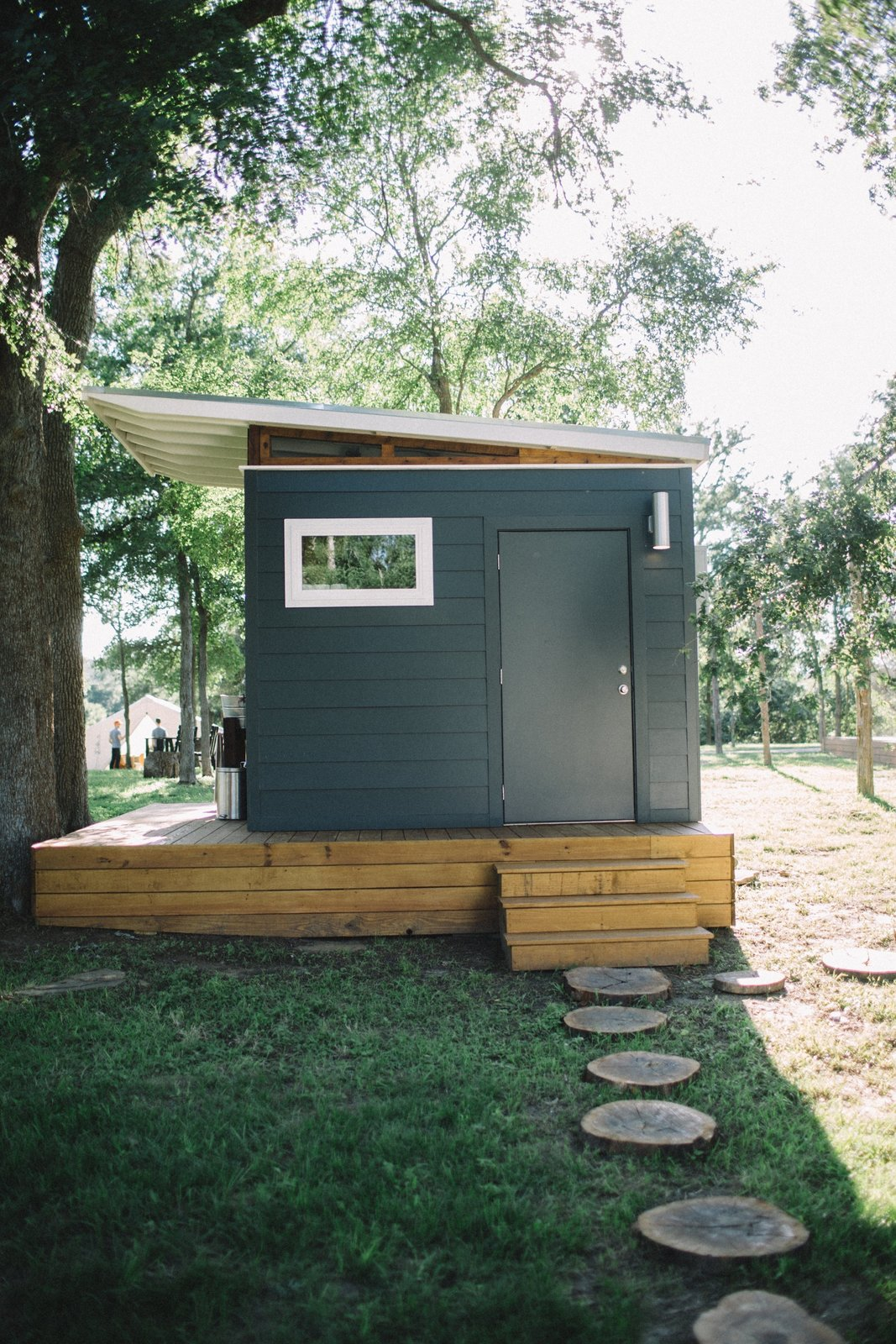 Whether you're renting a yurt or hosting a small gathering, you'll have access to a modern bathhouse with a full private shower room, a separate toilet, and a washer/dryer. Tagged: Outdoor, Trees, Grass, and Walkways.  Photo 5 of 8 in A Texas Camping Spot Complete With Yurts and Miniature Donkeys