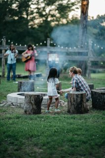 A corral fire pit brings everyone together, whether it's to roast marshmallows or listen to some acoustic tunes.