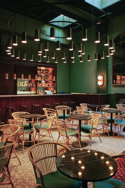 Hovering over the Libertine bar/restaurant in Casa Bonay is a massive lighting installation by Santa & Cole, Barcelona-based creators and editors who designed the industrial lighting throughout the space.
