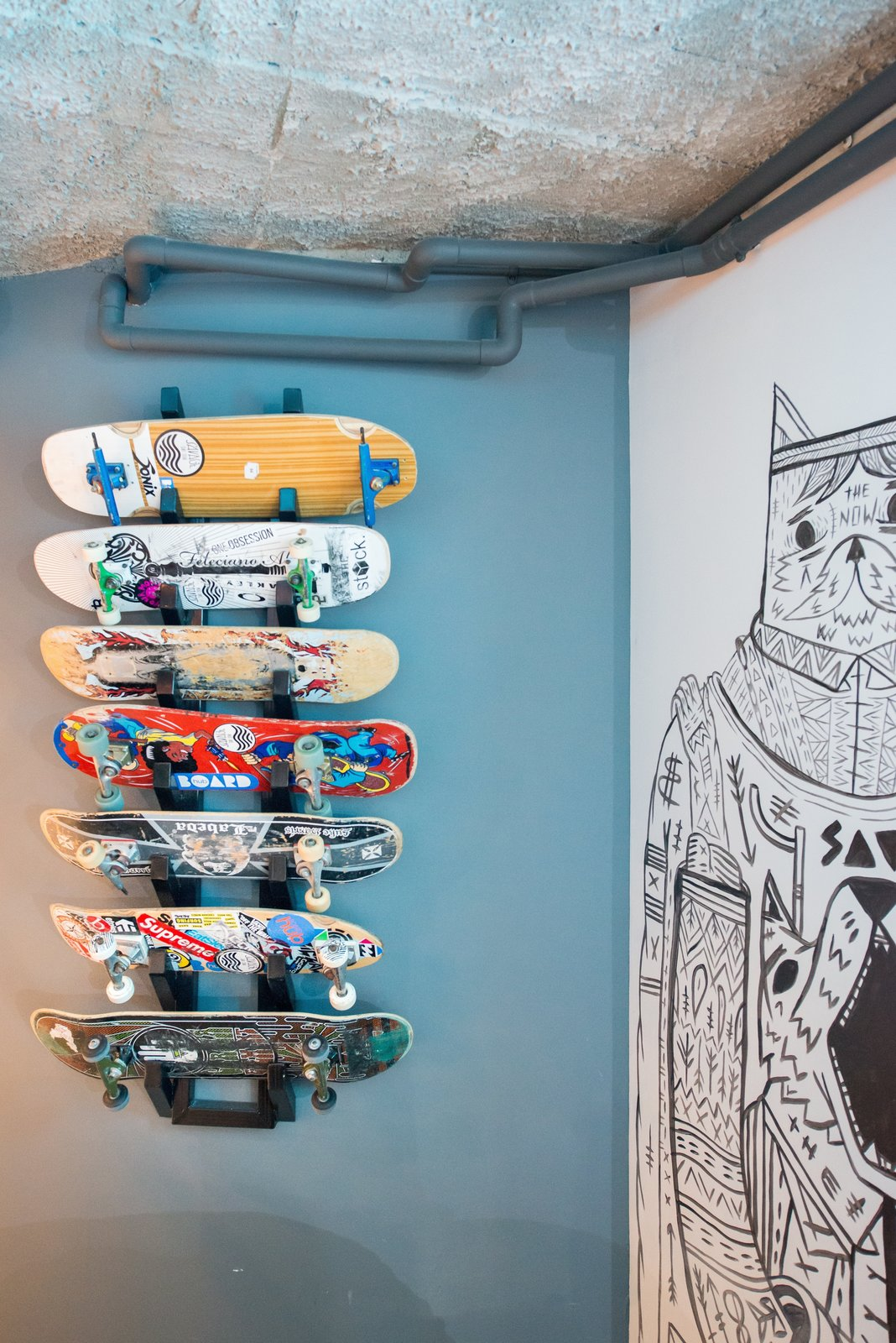 A custom board rack provides a space for showing off prized decks.