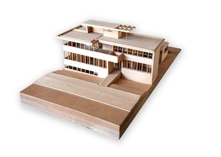 Iconic Perspectives: Richard Neutra's VDL Studio & Residences - Photo 4 of 10 - Perched on a piano towards the front of the house is a wooden model that was developed by Cal Poly Pomona students. It illustrates the original VDL residence design before it was destroyed in the 1963 fire. The piano it sits on belonged to Neutra's wife Dione where she would regularly play and sing. Neutra had cut off the original legs and replaced them with chromed tubular legs for a more modern look.