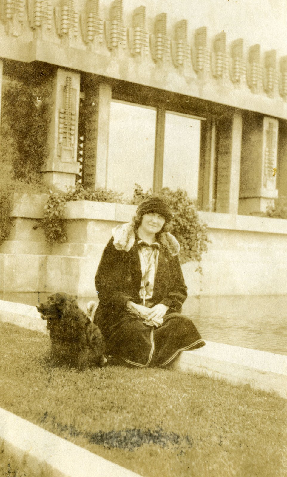 Shown here is Aline Barnsdall herself, lounging on the grounds of the Hollyhock House with her dog. The story of the residence could not be told without the powerful presence she held over the project. From the collection of David Devine, courtesy of the Hollyhock House