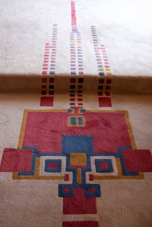 Iconic Perspectives: Frank Lloyd Wright's Hollyhock House - Photo 7 of 13 - The thoughtful repetition of the hollyhock motif was pointed out everywhere we went. Even the living space rug—which was also designed by Wright—featured the motif with a range of bright colors. The original version (this is a reproduction) was built as one large piece that covered the living room and the extended spaces surrounding it without any seams.