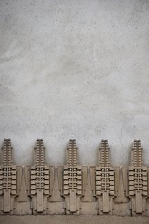 Iconic Perspectives: Frank Lloyd Wright's Hollyhock House - Photo 11 of 13 - The hollyhock motifs lining the exterior of the building were thought to have been created on-site by combining dry natural materials with water into a mold that would then form into the desired shape. The use of clay created the look and feel of concrete that's clearly influenced by pre-Columbian indigenous architecture.
