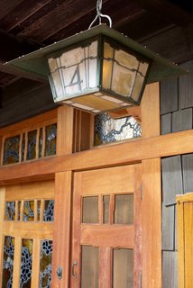 Iconic Perspectives: Greene & Greene's Gamble House - Photo 5 of 7 - The home is surrounded by open porches that are constructed of cedar. The house's art glass—shown here on the front door—acted as a way to bring light into the space before there was electricity.