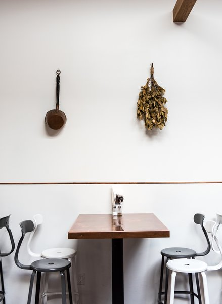 The copper tables are all custom produced by Chris Mast out of the East Bay, who also provided the copper trim in the wall and on the bar.  Photo 4 of 7 in A San Francisco Greek Restaurant That's Become a Neighborhood Staple