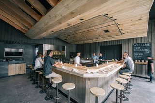 The Classic Hand Roll Bar Makes a Comeback at a New Los Angeles Sushi Spot - Photo 1 of 4 - At KazuNori's new second location, Marmol Radziner built the U-shaped bar out of bleached eucalyptus wood, while the walls are made of plaster and board-and-batten wood. The sculptural dropped ceiling is constructed of bleached rustic white oak and lined with a warm lighting scheme.