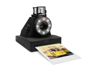 Impossible Project's I-1 Analog Instant Camera Revives a Nostalgic Art - Photo 3 of 3 - The modern version of the classic Polaroid silhouette is finished in a matte black surface with subtle yellow details. Impossible film packs are available in either colored or black and white and cost $19.99 for a pack of eight.