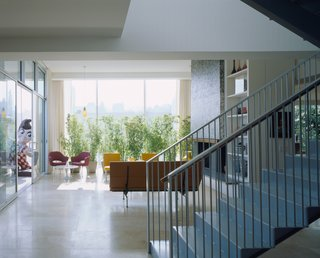 Dwell Home Tours Makes its Way to Portland - Photo 6 of 17 - The interior features French limestone floors, glass mosaic wall tiles by Ann Sacks, and sliding glass doors from Kawneer.