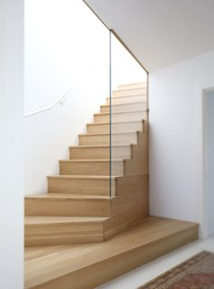 Dwell Home Tours Makes its Way to Portland - Photo 9 of 17 - Robinson built an airy wood stairway to bring more light up onto the second and third floors. The updated third floor looks out to views of Portland's West Hills.