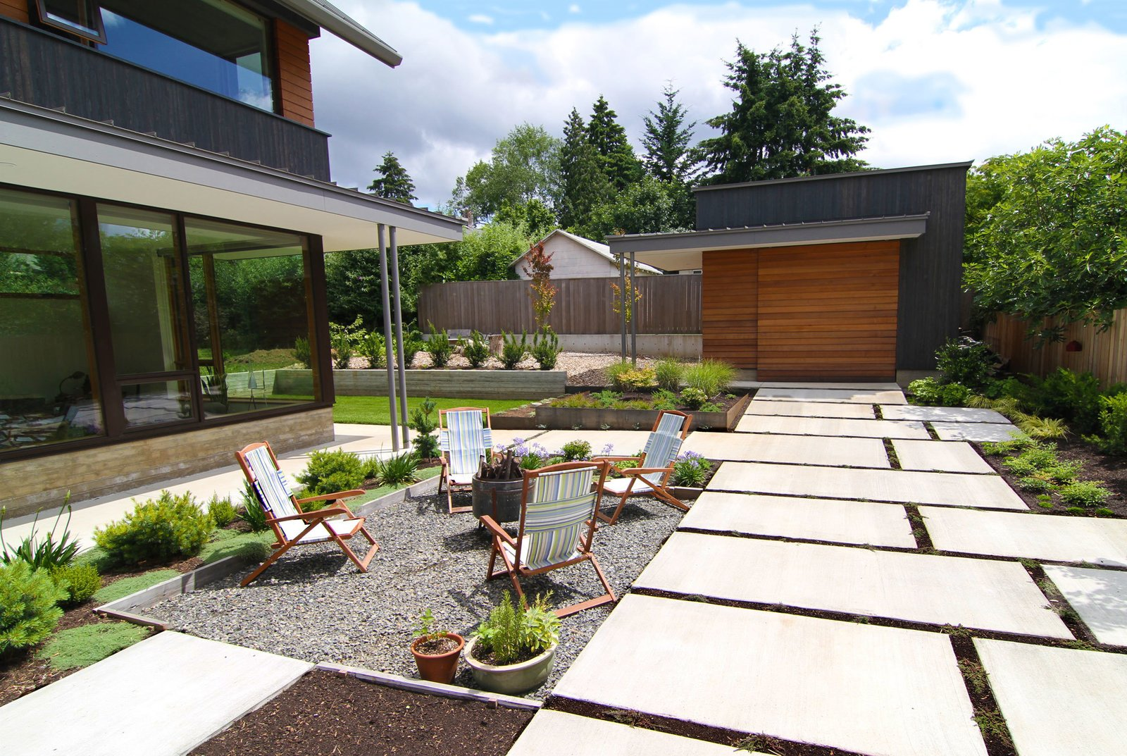Shown here is the exterior private courtyard, where McClellan and Williams did their own landscaping.  house pics by Joseph Fields from Dwell Home Tours Makes its Way to Portland