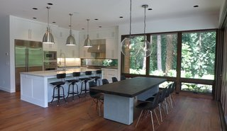 Dwell Home Tours Makes its Way to Portland - Photo 16 of 17 - Olson worked with Jessie Sweet to design the interiors. The kitchen hosts cabinetry from Oregon Custom Cabinets and a specialized window is integrated into the backsplash.