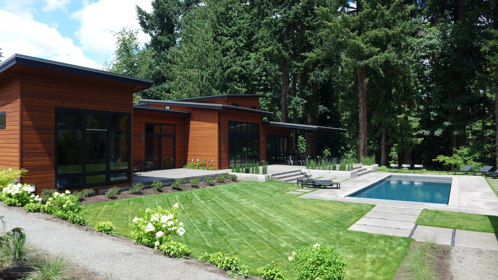 From the back of the house, two 15-foot bi-folding doors from Centor fully open up into the main living area.  house pics by Joseph Fields from Dwell Home Tours Makes its Way to Portland