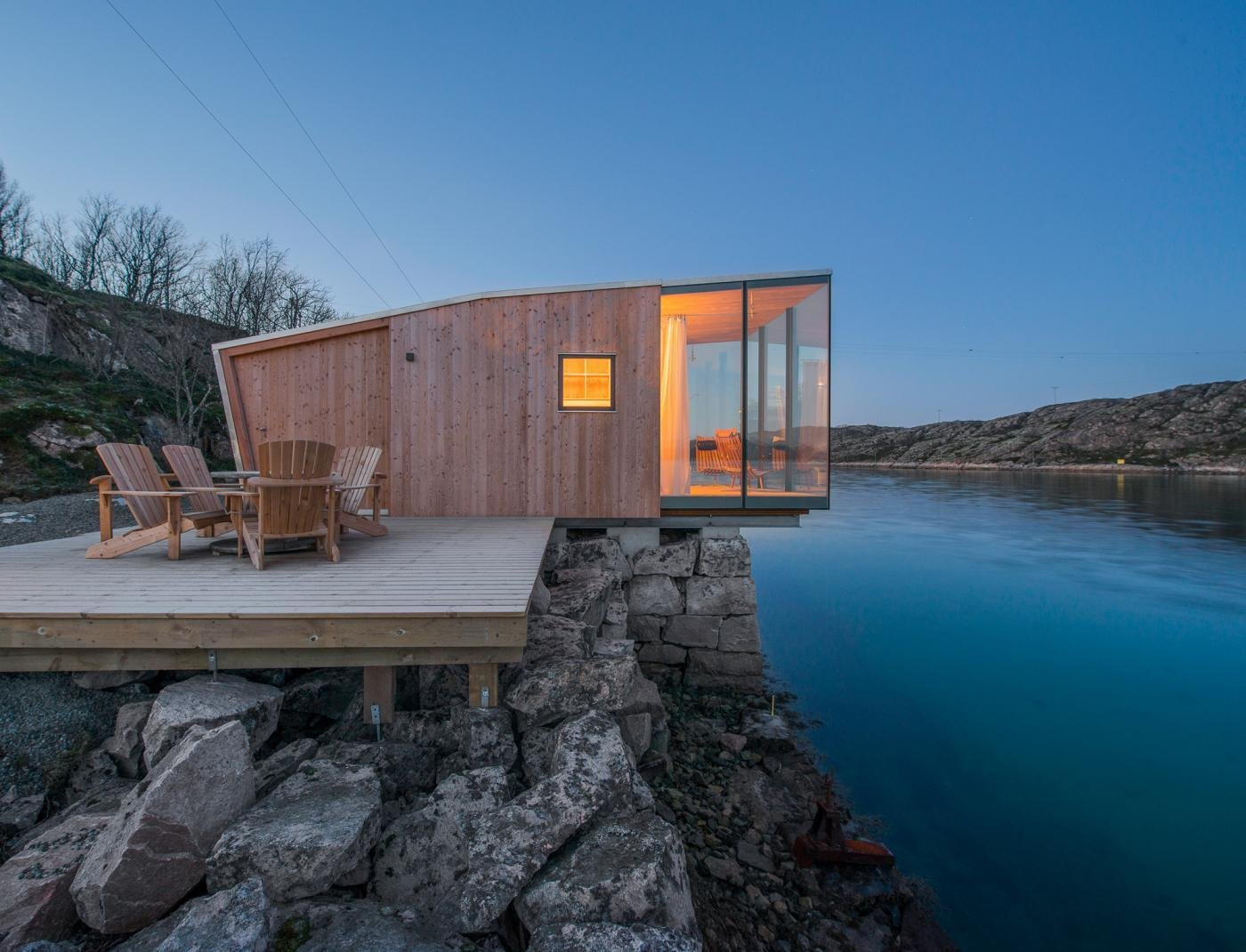 The cabins are made up of two layers of wood construction. The exterior layer is made of Larch wood with a custom glazing. Tagged: Small Patio, Porch, Deck, Wood Patio, Porch, Deck, Exterior, Wood Siding Material, and House. Deck by Matthew Kersplatt Silvers