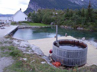 Have You Ever Wanted to Stay in a Norwegian Sea Cabin? - Photo 6 of 8 - When you arrive at Manshausen, you'll find a hot tub that you can enjoy at your leisure. It holds up to 14 people and leads down to a dam that holds salt water that's pumped into the contained area to keep it fresh.