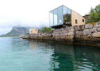 Have You Ever Wanted to Stay in a Norwegian Sea Cabin? - Photo 1 of 8 - This boutique hotel on Norway's Manshausen Island is made up of four sea cabins that jut out from their natural ledge. Architect Snorre Stinessen carefully positioned them on an existing stone quay and built them to fit two to four travelers, or a family of five. To allow them to cantilever off the edge, their cross-laminated timber floor plates are mounted onto two steel beams.