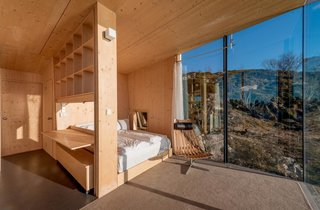 Each hut consists of two bedrooms with double beds, a small alcove, bathroom, shower, and small kitchen. Stinessen made sure to provide enough built-in storage for visitors, while also sticking to raw pine surfaces.