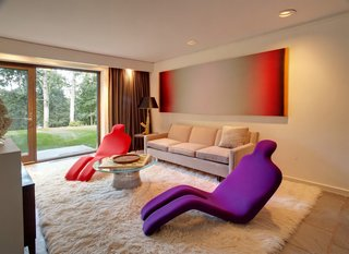 Shown here is the sitting room from the bottom half of the main house. As an art collector, the current homeowner has filled the entire interior with bold statement pieces.