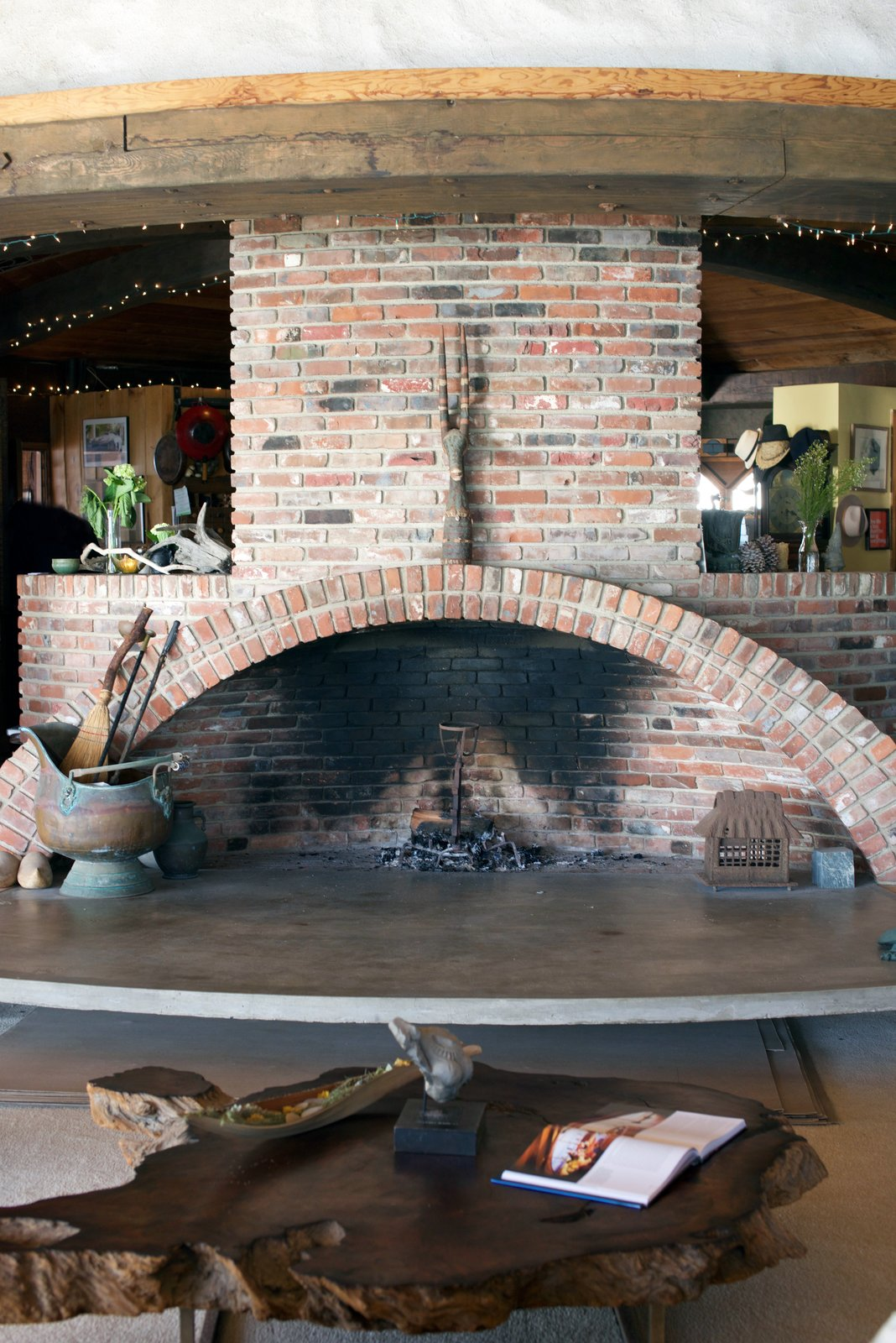 The kitchen is found on the other side of the fireplace. #harrygesner #sandcastle #iconichouses  Best Photos from Behind the Scenes at Harry Gesner's Sandcastl