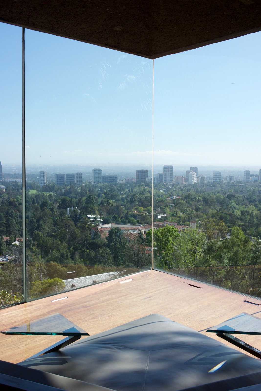The bedroom holds custom gray leather lounging beds with angular side tables made of glass and steel.  Behind the Scenes at John Lautner's Sheats-Goldstein Residence by Paige Alexus