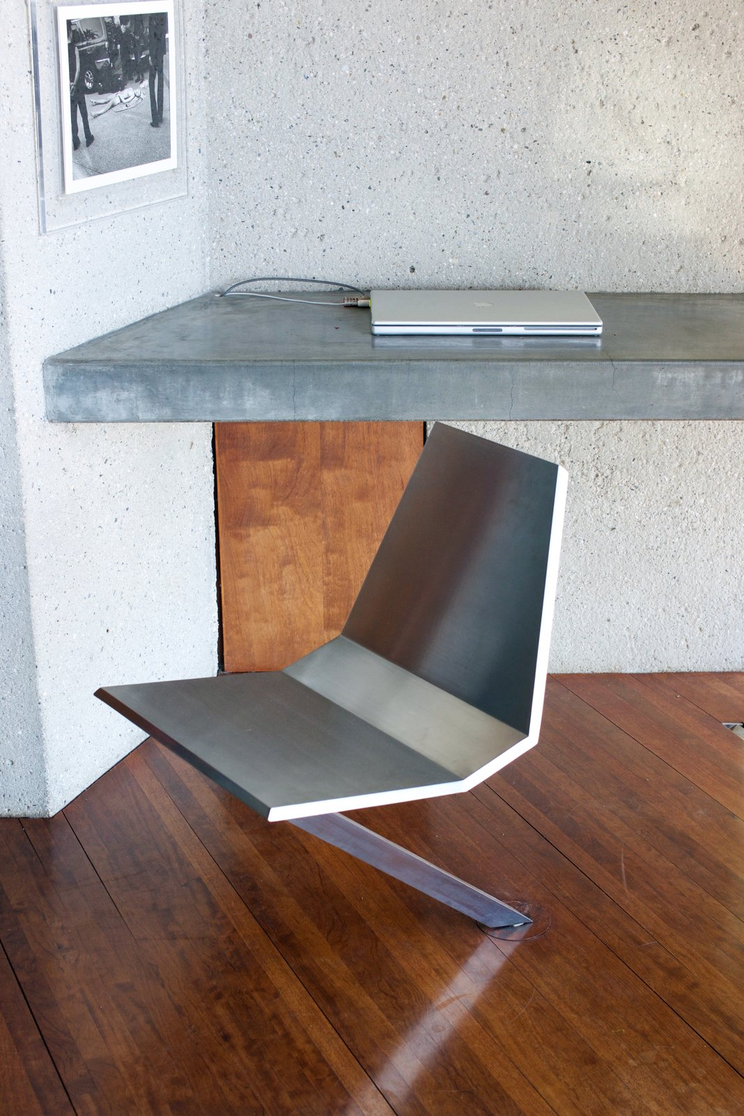 The stainless-steel swivel chair was made custom and rotates directly from the floor. It was designed by Lautner's protege, Duncan Nicholson—who helped oversee the renovations of the house.