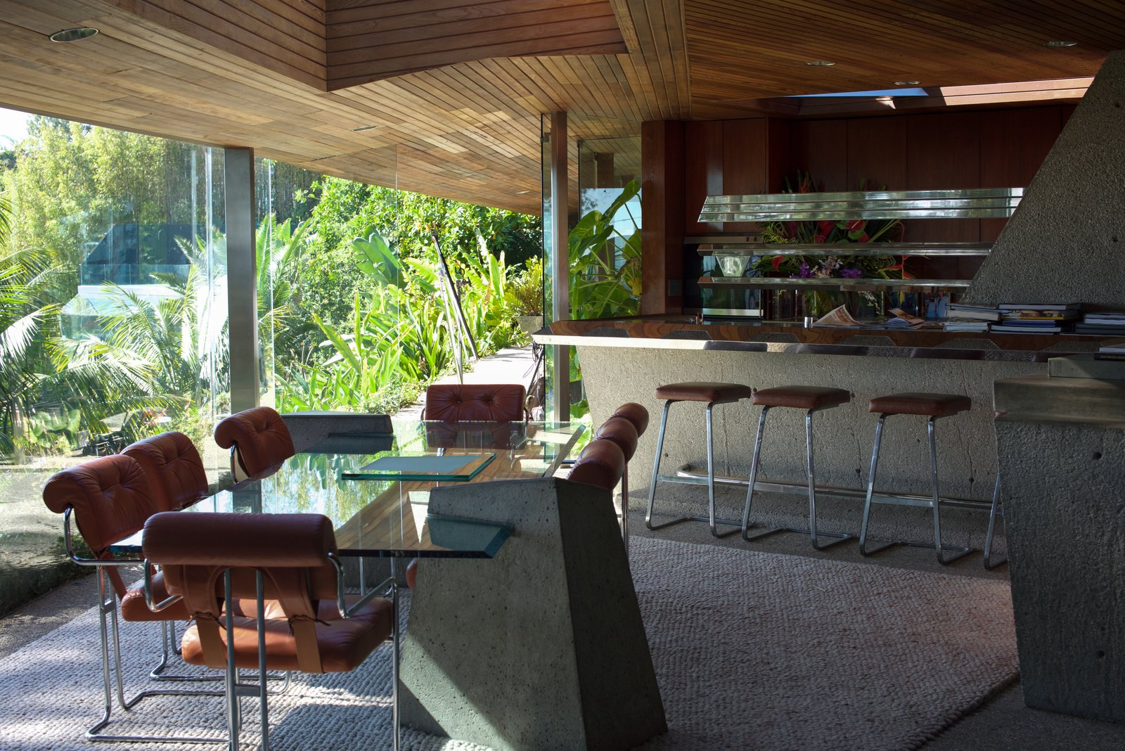 The glass table in the dining room was a Lautner-designed piece that he created for Goldstein.  Behind the Scenes at John Lautner's Sheats-Goldstein Residence by Paige Alexus