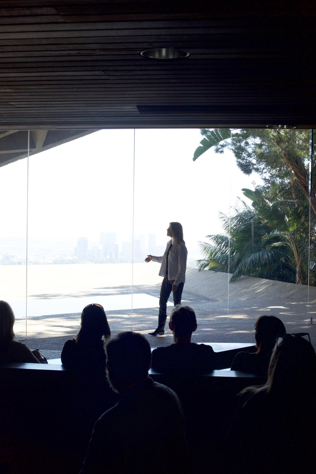 James Goldstein's associate shared with the touring group the story of the house while standing in front of the pool.  Behind the Scenes at John Lautner's Sheats-Goldstein Residence by Paige Alexus