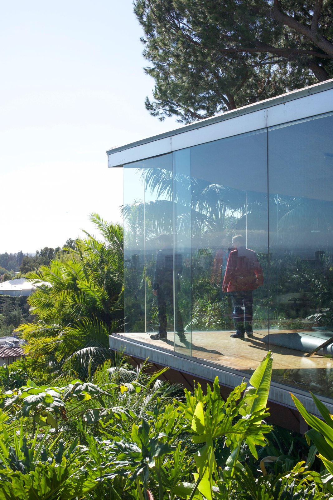 "The seamless glass opens up automatically at sharp points. This emphasizes the ""sense of danger"" that's consistent throughout.  Behind the Scenes at John Lautner's Sheats-Goldstein Residence by Paige Alexus"
