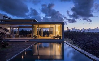 These 7 Hawaiian Modernist Escapes Will Have You Dreaming of the Islands - Photo 6 of 7 - Located on Hawaii's Big Island, the Lavaflow 1 - Robert Trickey House was designed by San Francisco-based architect, Craig Steely. Captured by architectural photographer Mike Kelley, this home and studio was built on hardened lava from the 1955 Kilauea eruption.