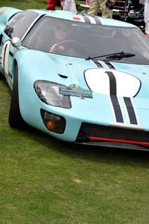 A Day at the Pebble Beach Concours d'Elegance Car Show - Photo 2 of 9 - Brought to the event by the Revs Institute for Automotive Research, Inc. in Naples, Florida, this 1966 Ford GT40 raced for the first time at the 12 Hours of Sebring race in 1966. After enduring several eventful races, it concluded its career after participating at Montlhéry. It's been carefully preserved ever since.